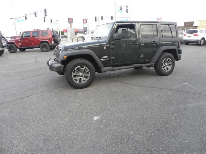 2012 GREEN /BLACK Jeep Wrangler Unlimited Sport 4WD (1C4BJWDG1CL) with an 3.6L V6 DOHC 24V FFV engine, AUTOMATIC transmission, located at 607 W Columbia Drive, Kennewick, WA, 99336, (509) 582-8818, 46.216743, -119.126404 - Photo #0